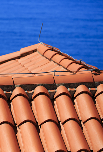 Mediterranean terracotta tiled roof with lightning conductor in Dubrovnik, Croatia