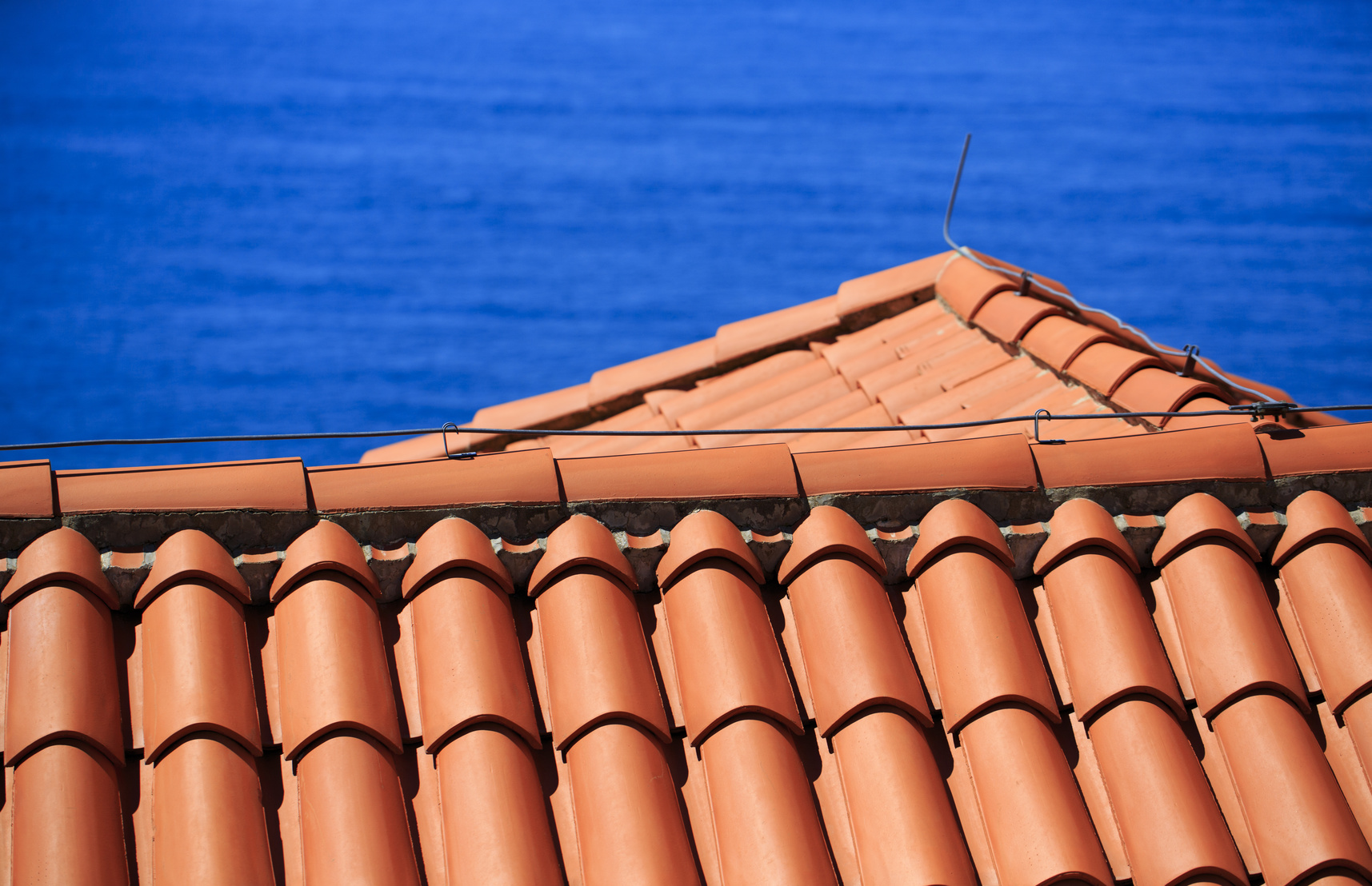Mediterranean terracotta tiled roof with lightning conductor